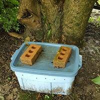 bricks on a composter lid